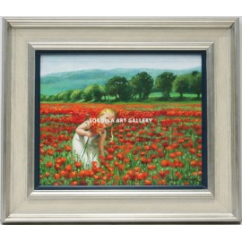 Girl picking poppies